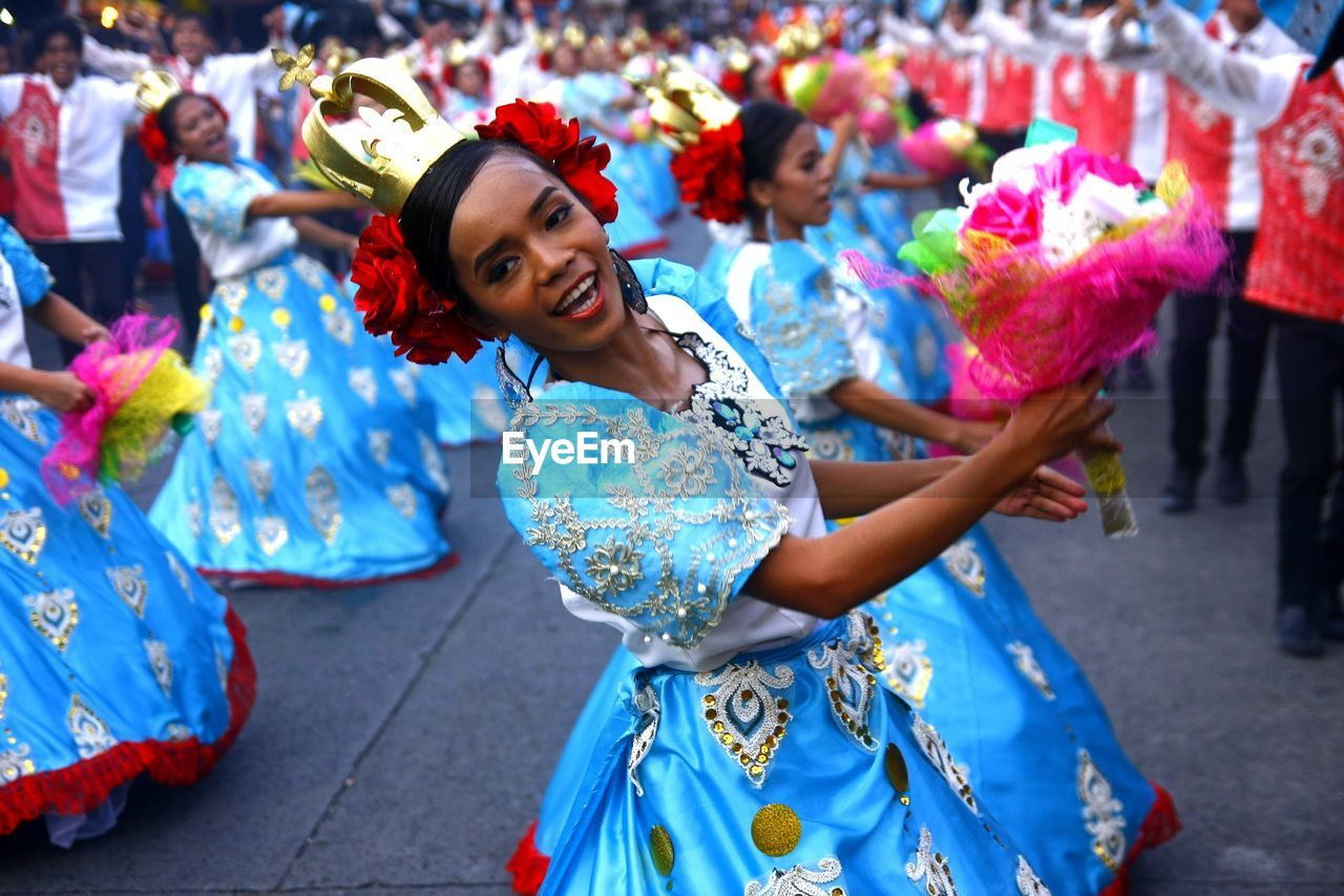 traditional clothing, dancing, smiling, happiness, women, young adult, lifestyles, celebration, real people, clothing, focus on foreground, leisure activity, emotion, people, young women, front view, adult, traditional dancing, human arm
