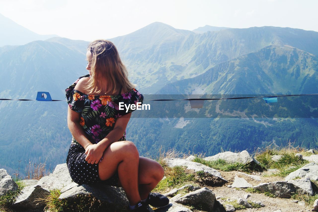 Woman sitting on mountain