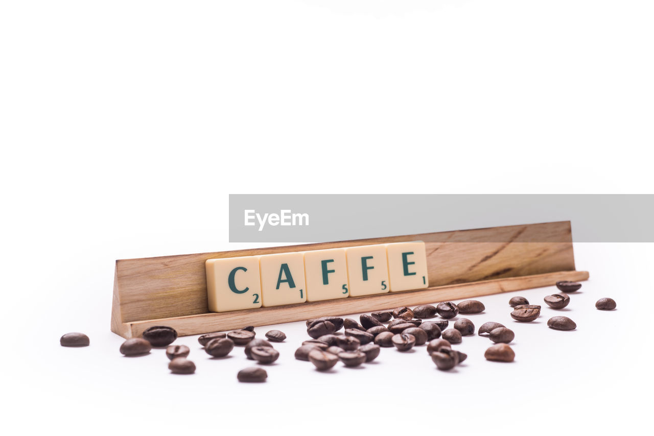 Information sign and roasted coffee beans on white background