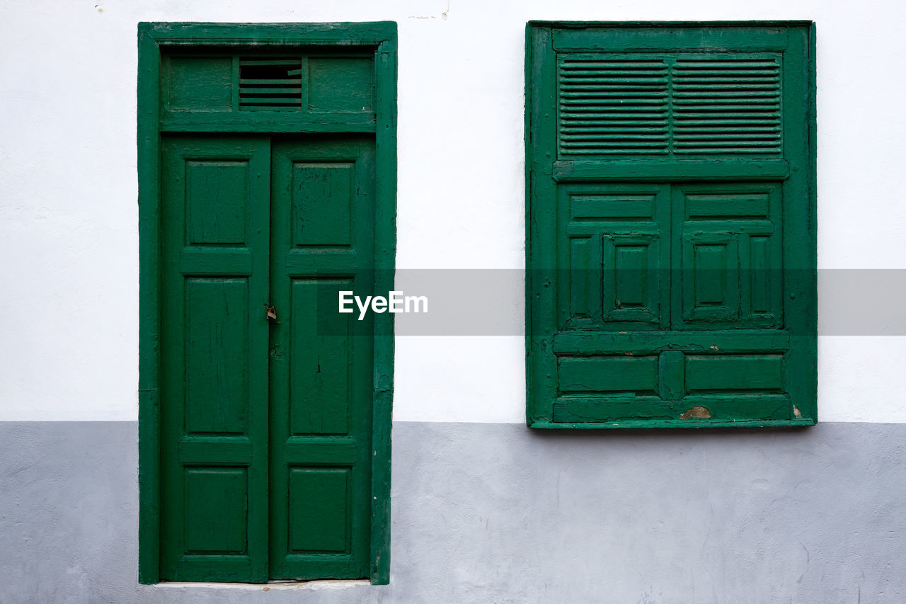 green color, architecture, built structure, entrance, door, building exterior, no people, building, closed, protection, safety, security, day, window, outdoors, house, wall - building feature, wood - material, green, white color, turquoise colored