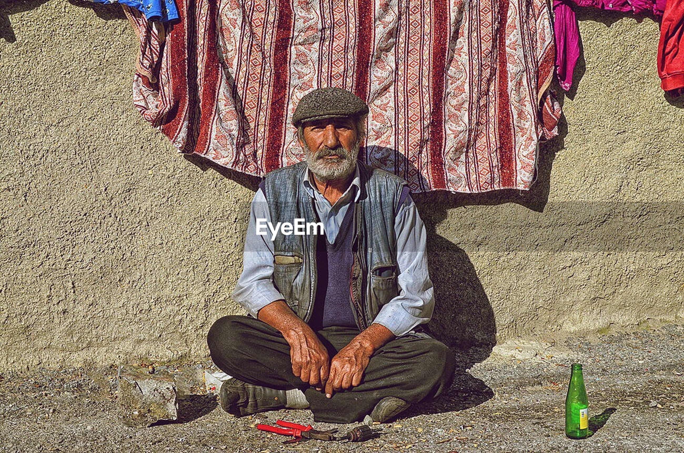 casual clothing, full length, lifestyles, childhood, leisure activity, sitting, holding, person, front view, elementary age, standing, traditional clothing, street, day, outdoors, boys, sunlight, girls