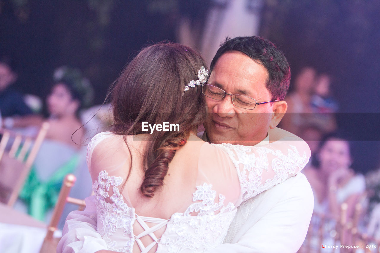 togetherness, real people, eyeglasses, two people, focus on foreground, love, leisure activity, lifestyles, celebration, wedding, men, bonding, women, outdoors, well-dressed, day, bride, wedding dress, adult, people