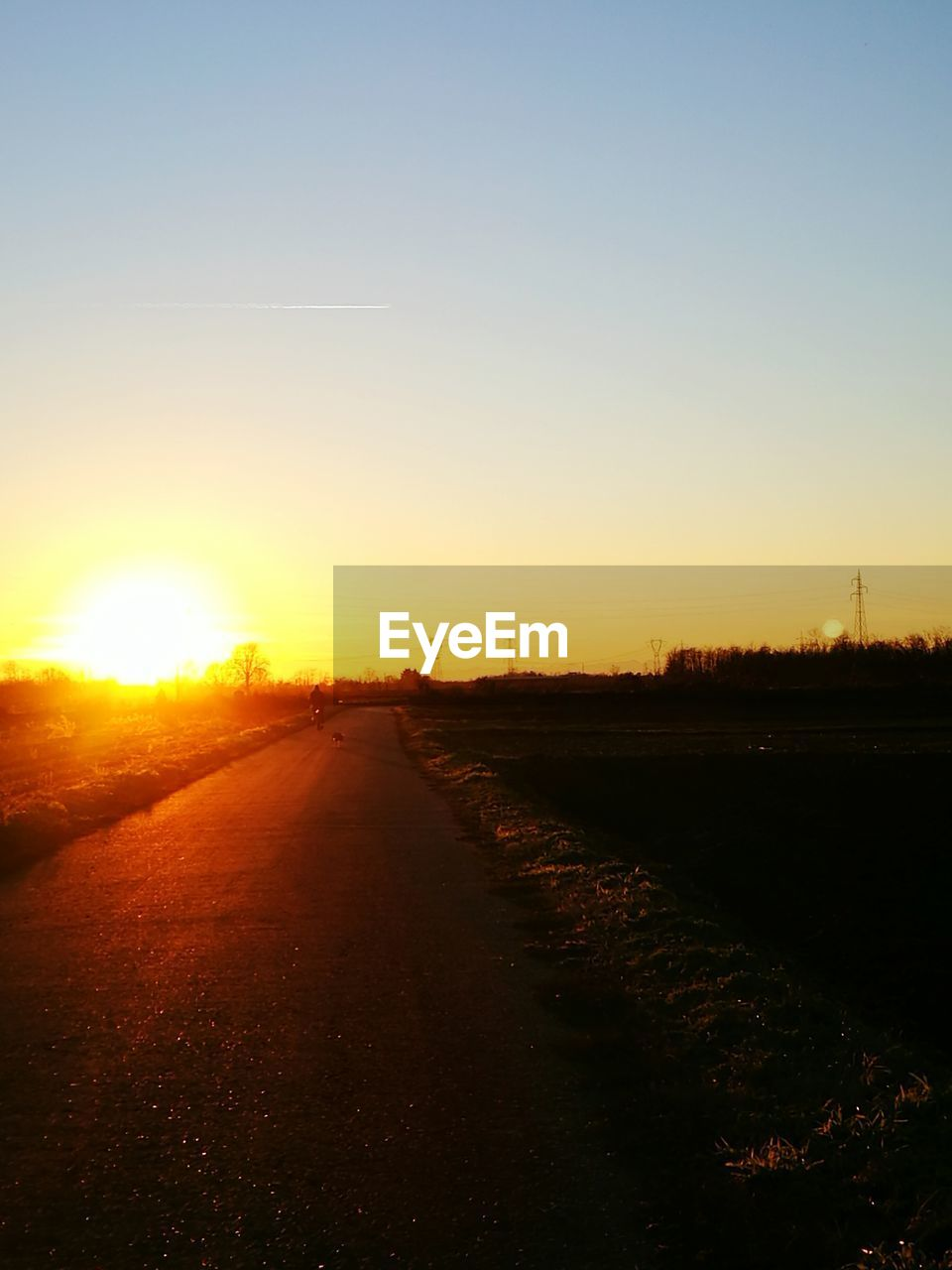 sunset, sun, the way forward, no people, road, sky, nature, sunlight, tranquil scene, outdoors, scenics, beauty in nature, landscape, clear sky, day