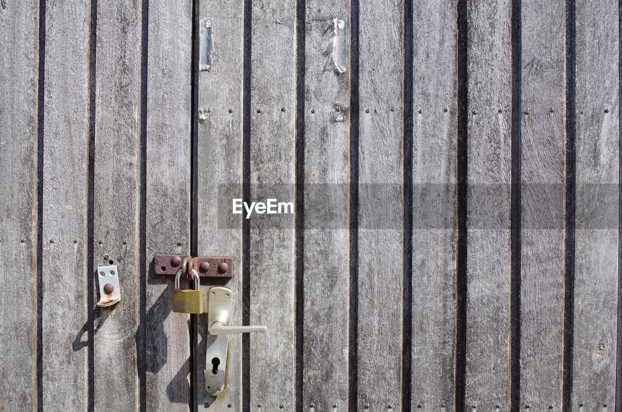 wood - material, metal, safety, no people, day, security, protection, lock, pattern, rusty, outdoors, entrance, barrier, backgrounds, wall - building feature, boundary, fence, padlock, old, door, latch