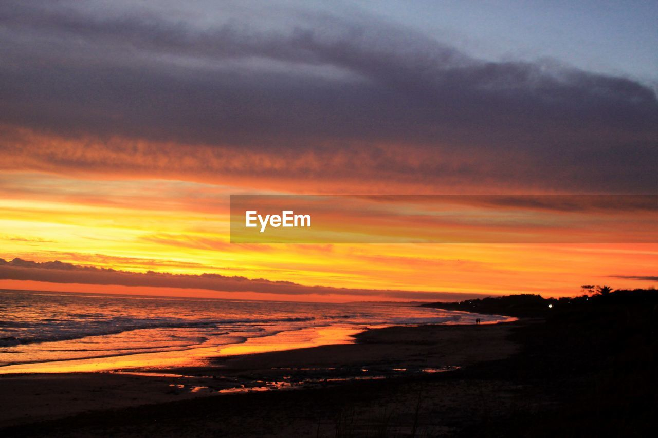 sunset, sky, cloud - sky, beauty in nature, scenics - nature, tranquility, orange color, tranquil scene, nature, idyllic, water, no people, sea, environment, beach, land, dramatic sky, horizon, outdoors, romantic sky