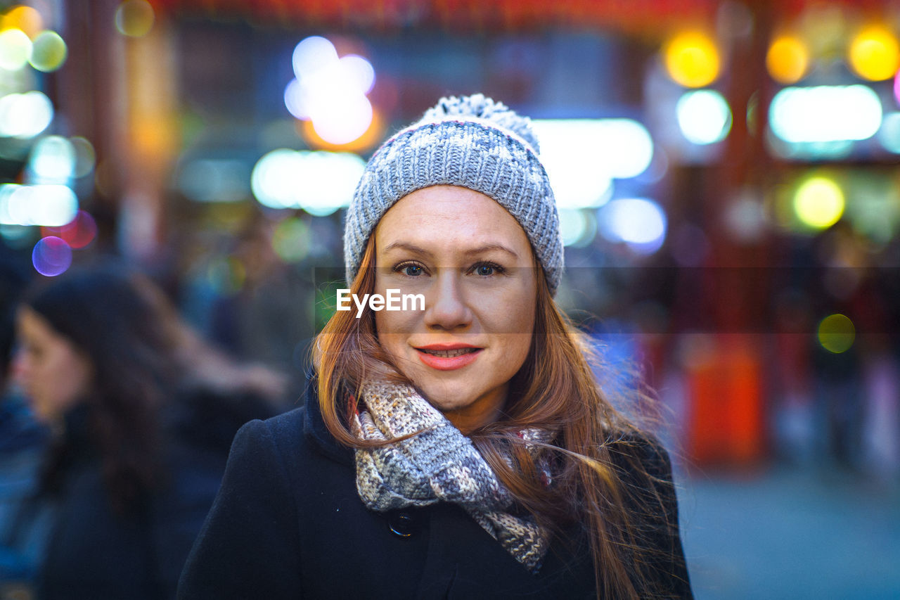 Portrait Of Woman In City At Night
