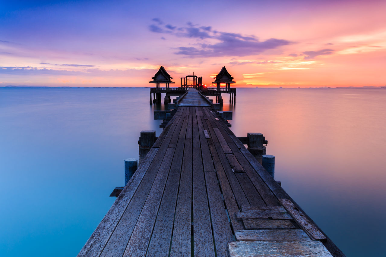 Scenic view of pier against sky during sunset
