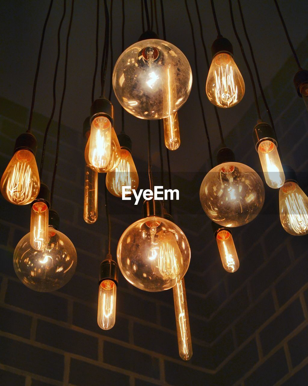 Low Angle View Of Bulbs Hanging On Ceiling