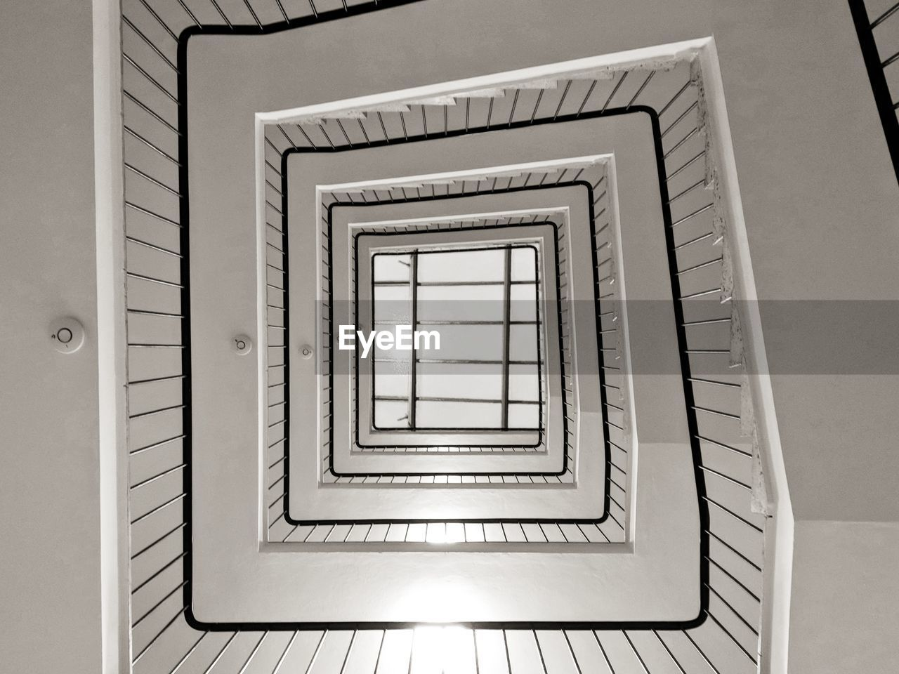 architecture, spiral staircase, spiral, steps and staircases, staircase, railing, built structure, indoors, no people, pattern, directly below, design, shape, diminishing perspective, geometric shape, building, directly above, repetition, high angle view, illuminated