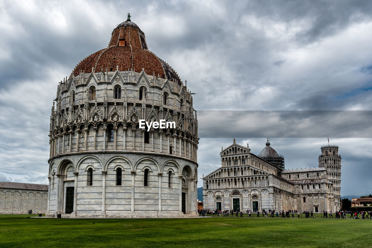 building exterior, built structure, architecture, cloud - sky, dome, sky, travel destinations, place of worship, religion, belief, tourism, grass, travel, day, spirituality, building, nature, history, the past, outdoors, government, ancient civilization