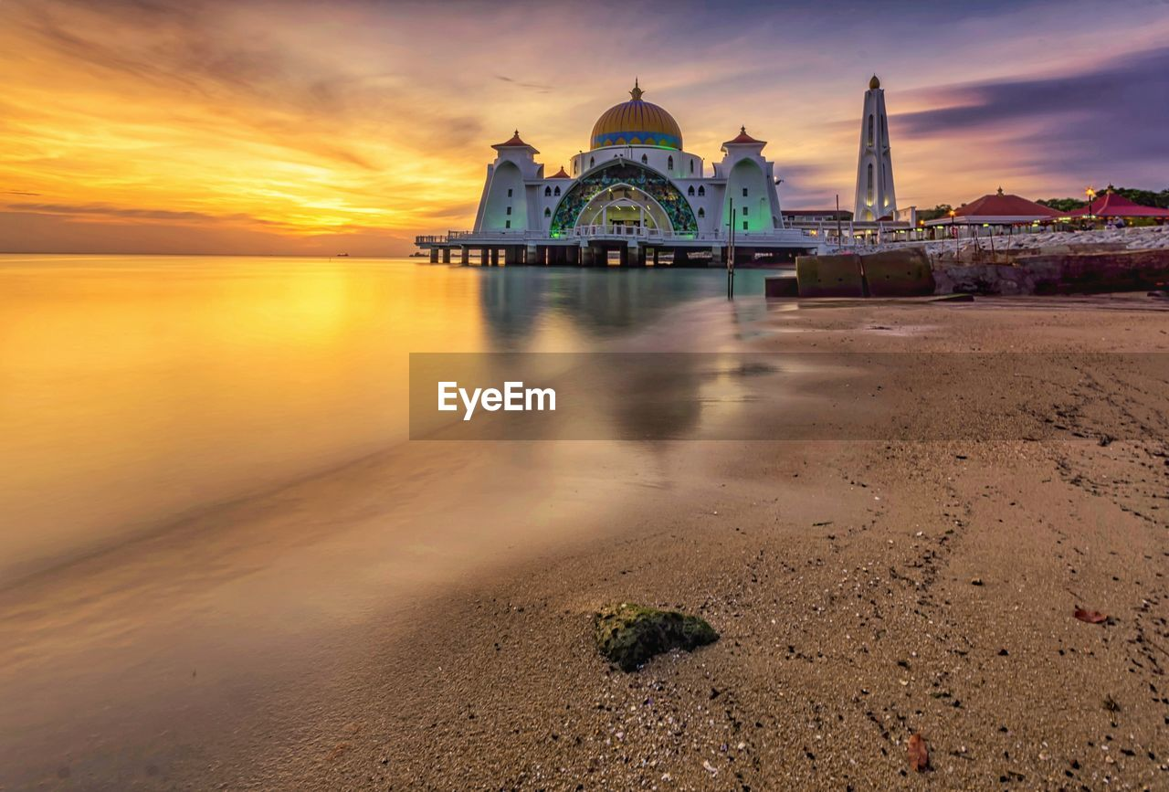 religion, spirituality, place of worship, architecture, dome, built structure, sunset, sky, building exterior, cloud - sky, water, travel destinations, reflection, outdoors, no people, beauty in nature, nature, day