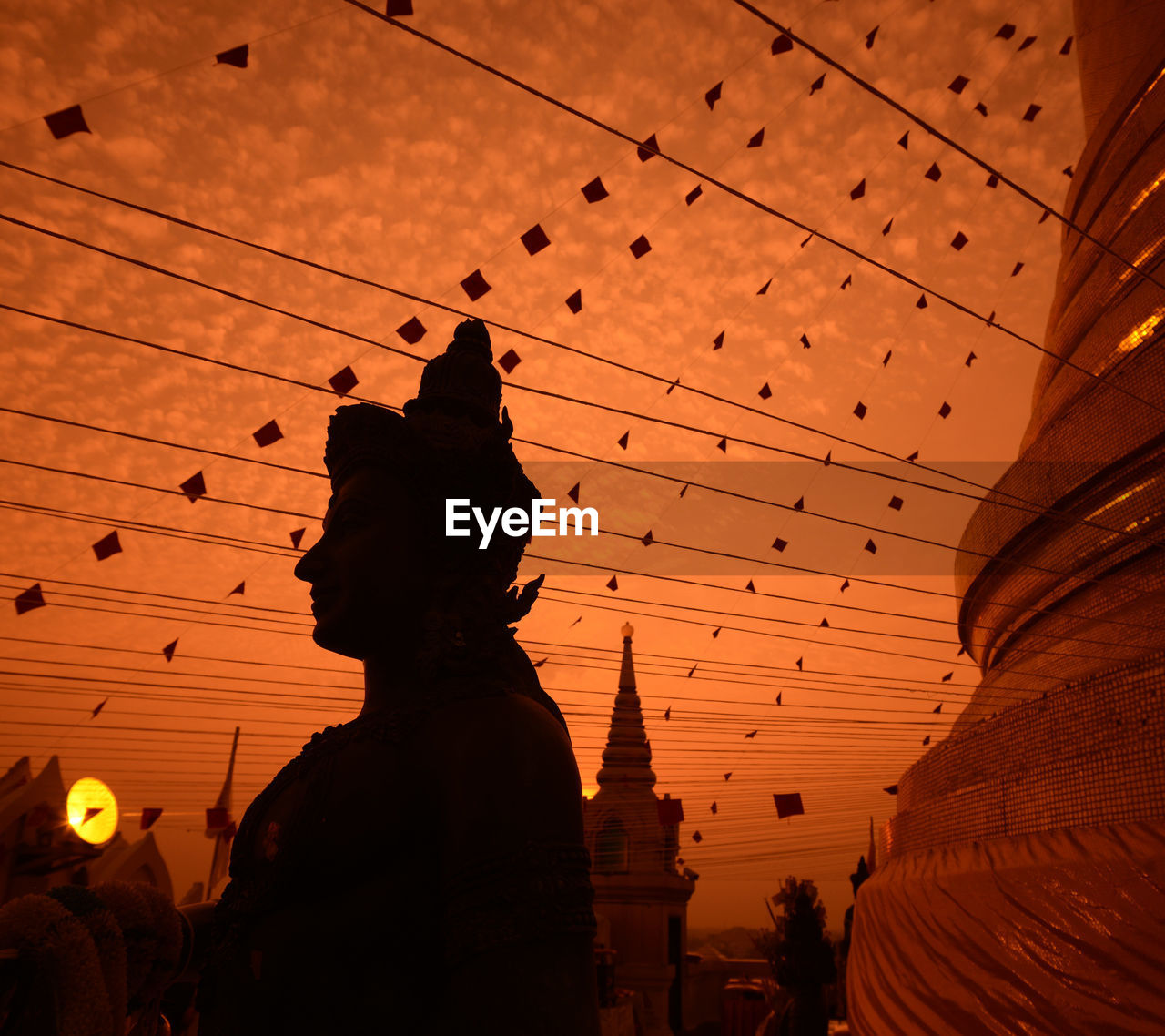 Buddha Statue At Temple Against Sky During Sunset