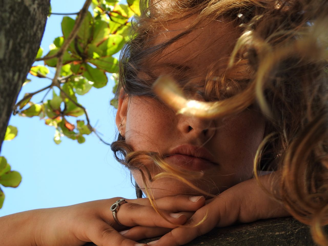 Close-Up Of Girl Against Tree