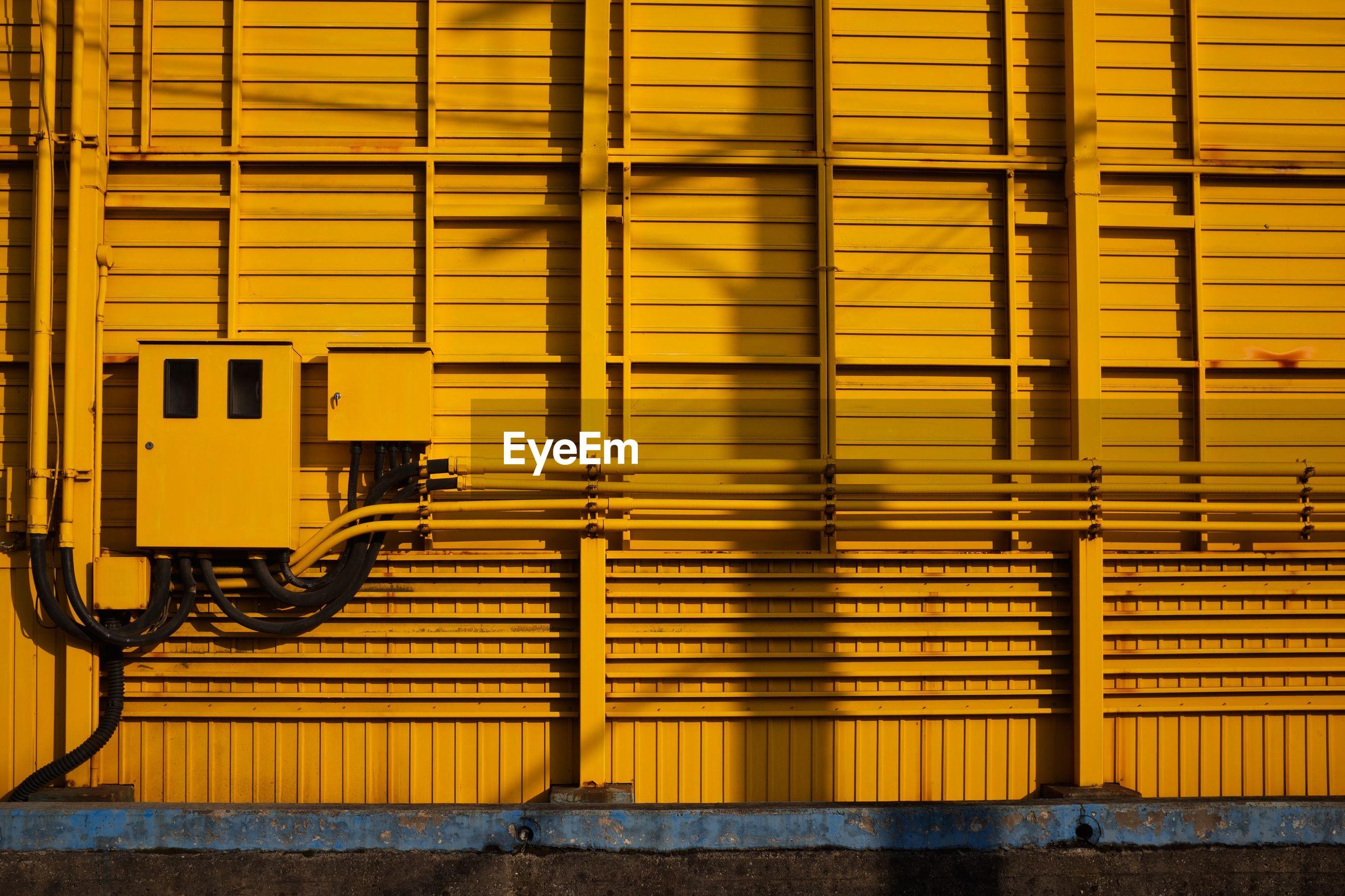 Fuse box yellow wall