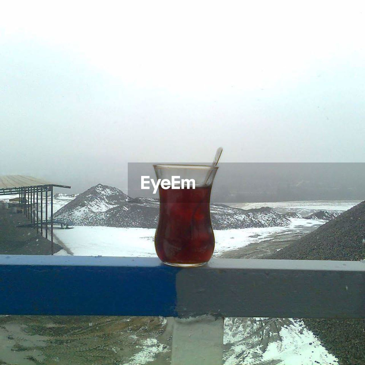 cold temperature, winter, ice, snow, weather, refreshment, drink, water, day, ice cube, no people, drinking glass, frozen, nature, outdoors, beauty in nature, sky, freshness, close-up