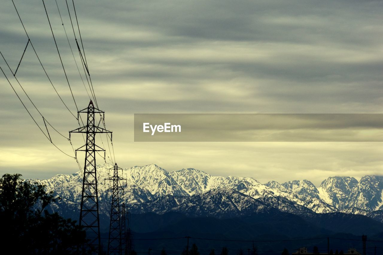 cable, technology, electricity, mountain, sky, cloud - sky, electricity pylon, connection, power line, snow, fuel and power generation, cold temperature, nature, scenics - nature, power supply, mountain range, winter, no people, beauty in nature, outdoors, snowcapped mountain
