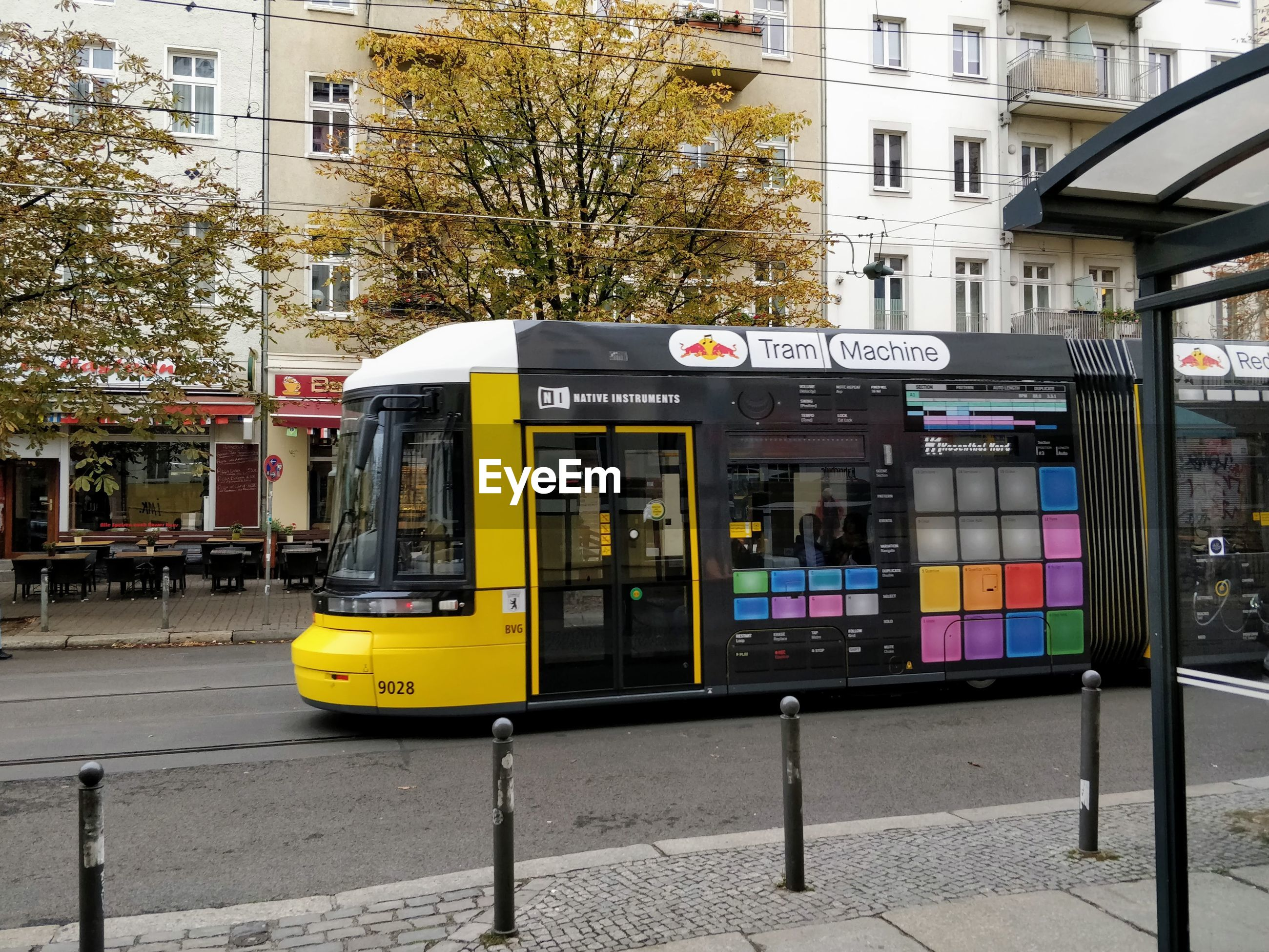 VIEW OF YELLOW TRAIN ON STREET