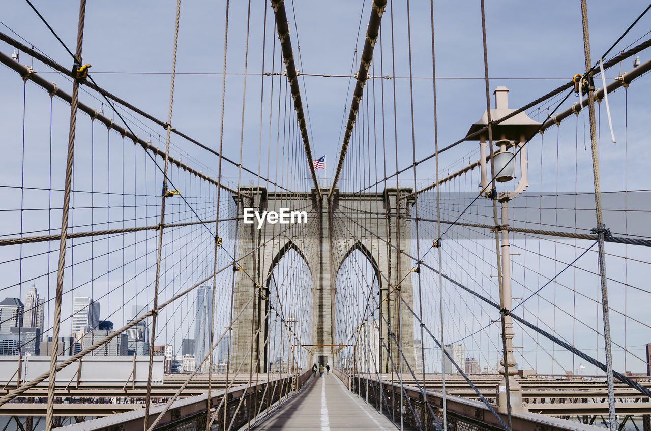 built structure, transportation, architecture, bridge, connection, suspension bridge, bridge - man made structure, engineering, sky, travel destinations, tourism, travel, direction, cable, cable-stayed bridge, nature, the way forward, steel cable, city, diminishing perspective, long