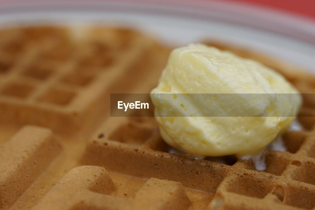 Close-Up Of Butter Melting On Waffle