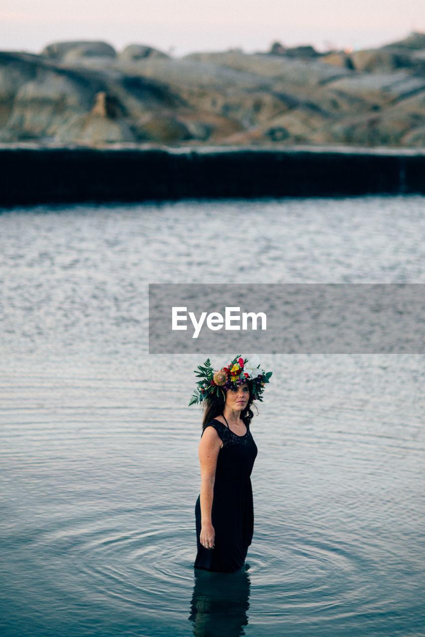 Woman Wearing Flowers In Sea