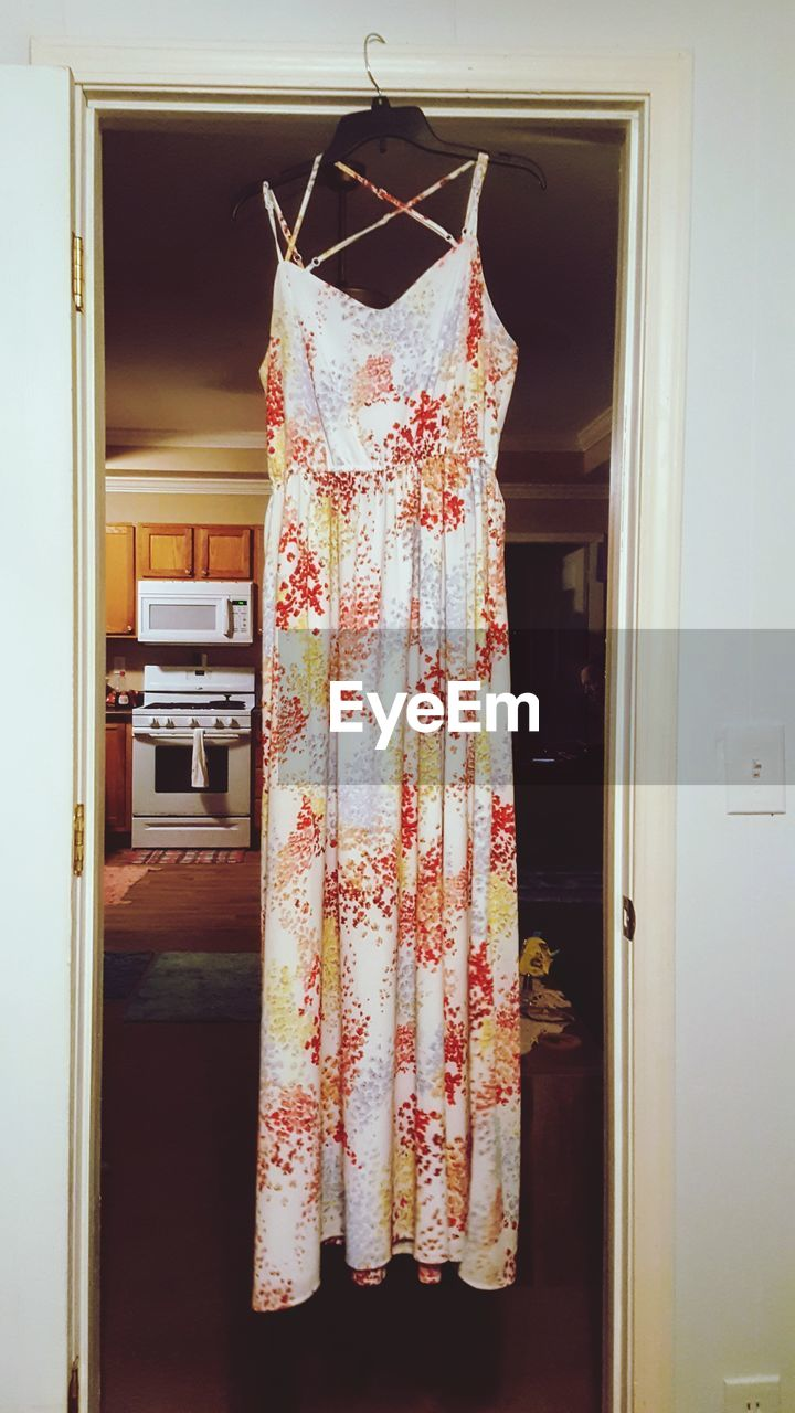 hanging, indoors, no people, home interior, entrance, clothing, door, coathanger, white color, home, domestic room, furniture, closet, dress, day, still life, floral pattern, textile, open, pattern