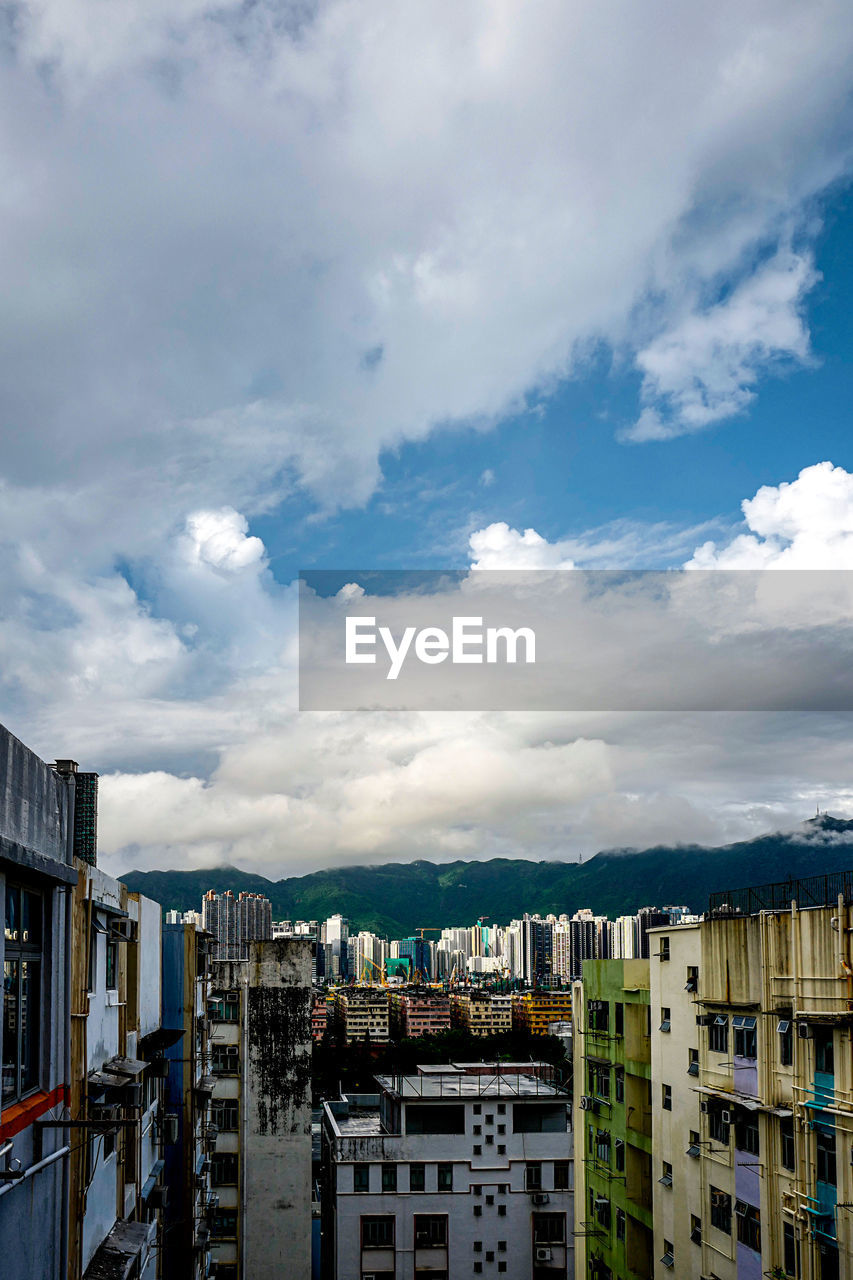 cloud - sky, architecture, building exterior, sky, built structure, building, residential district, city, day, nature, no people, mountain, outdoors, cityscape, house, window, mountain range, town, apartment, row house, townscape