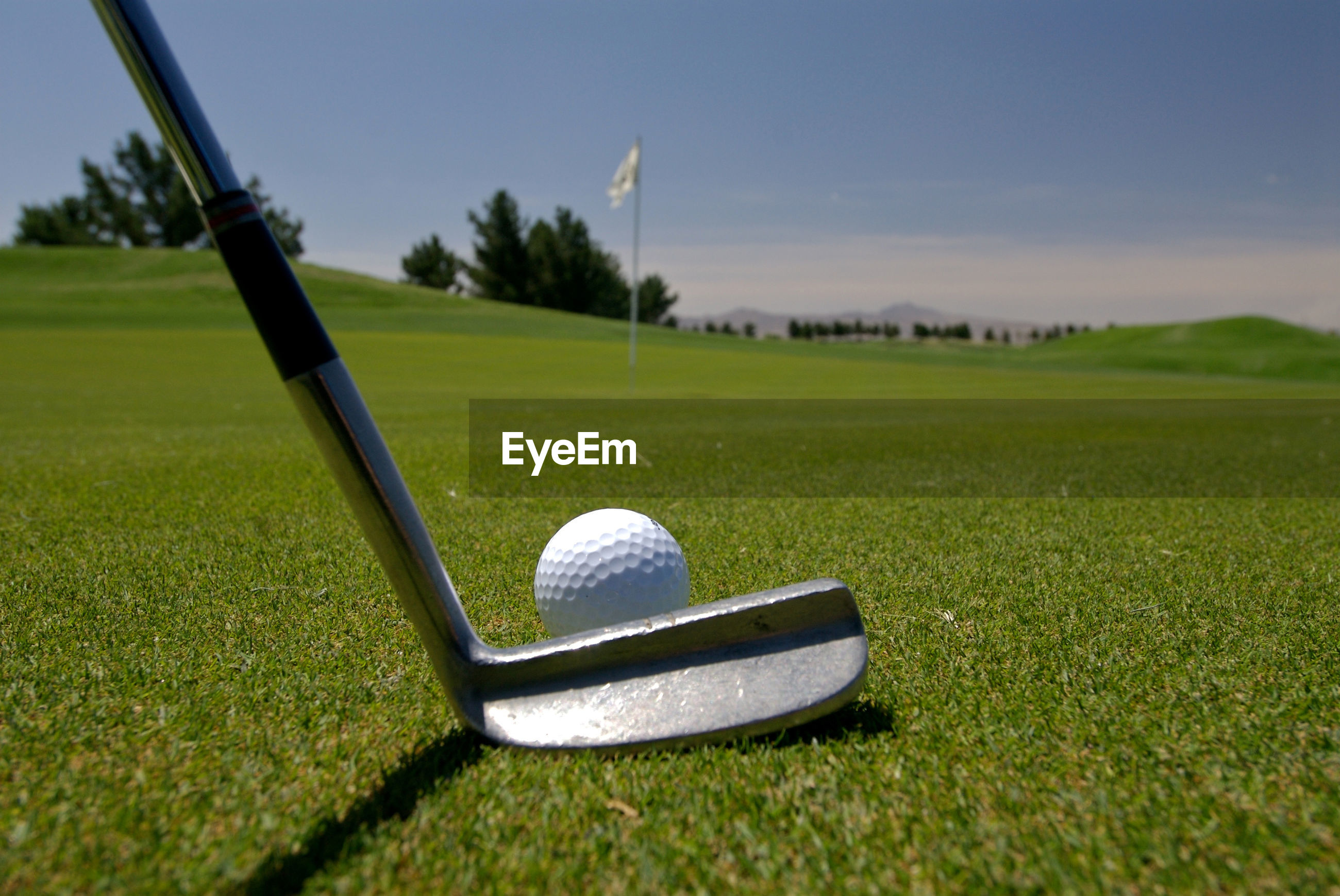 Close-up of golf club and ball