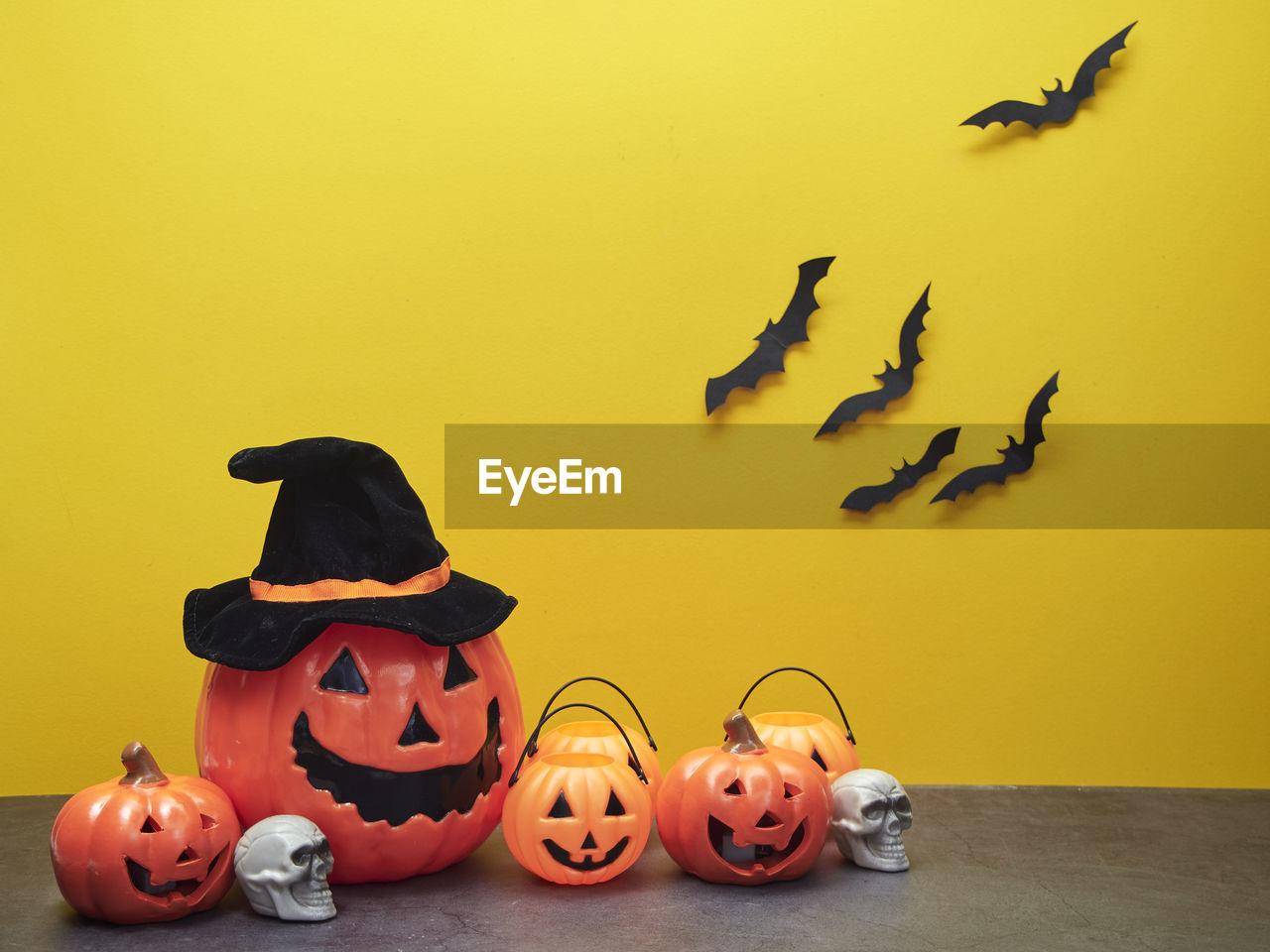 pumpkin, halloween, jack o' lantern, art and craft, creativity, food, representation, indoors, celebration, animal representation, anthropomorphic face, face, no people, still life, animal, table, animal themes, food and drink, anthropomorphic