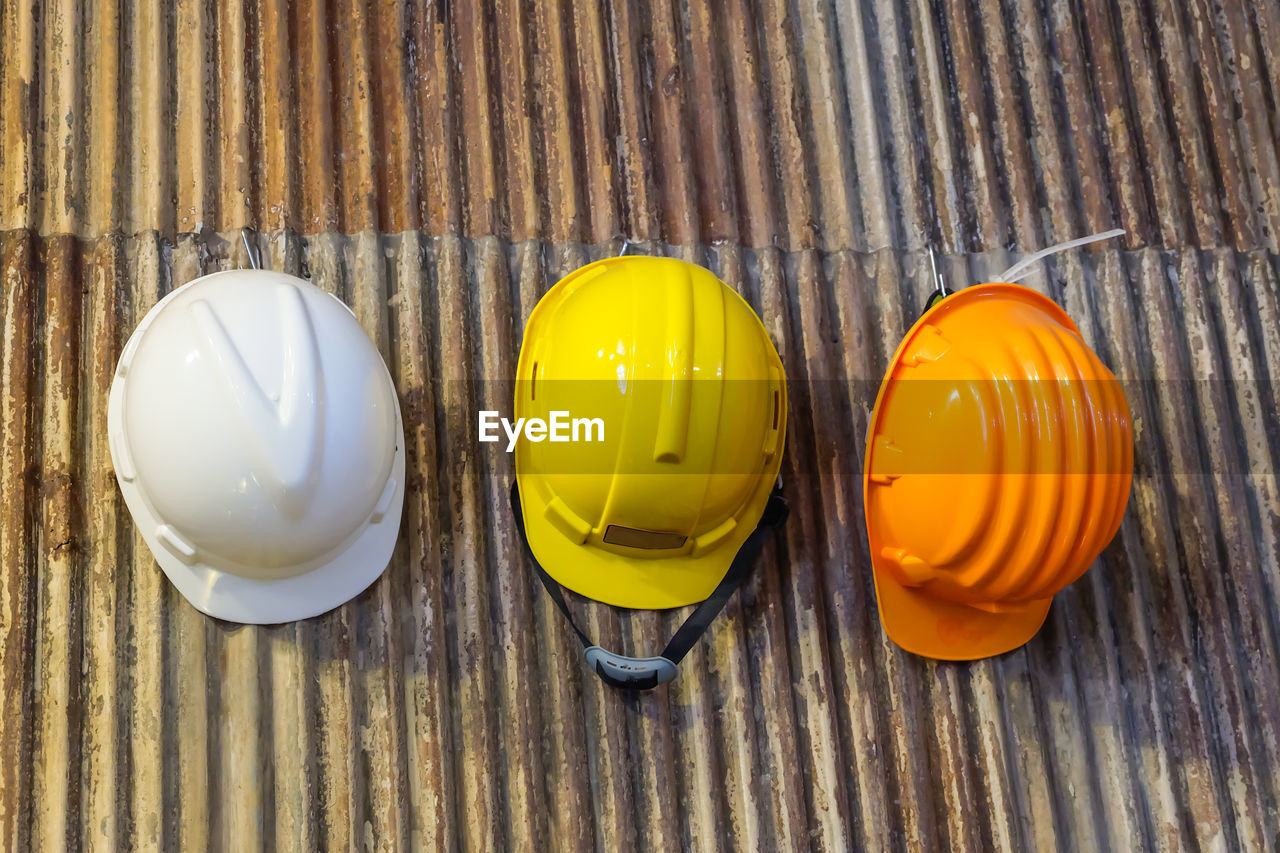 yellow, table, no people, wood - material, still life, directly above, indoors, close-up, high angle view, food and drink, textured, pattern, hat, hardhat, food, safety, helmet, headwear, shape