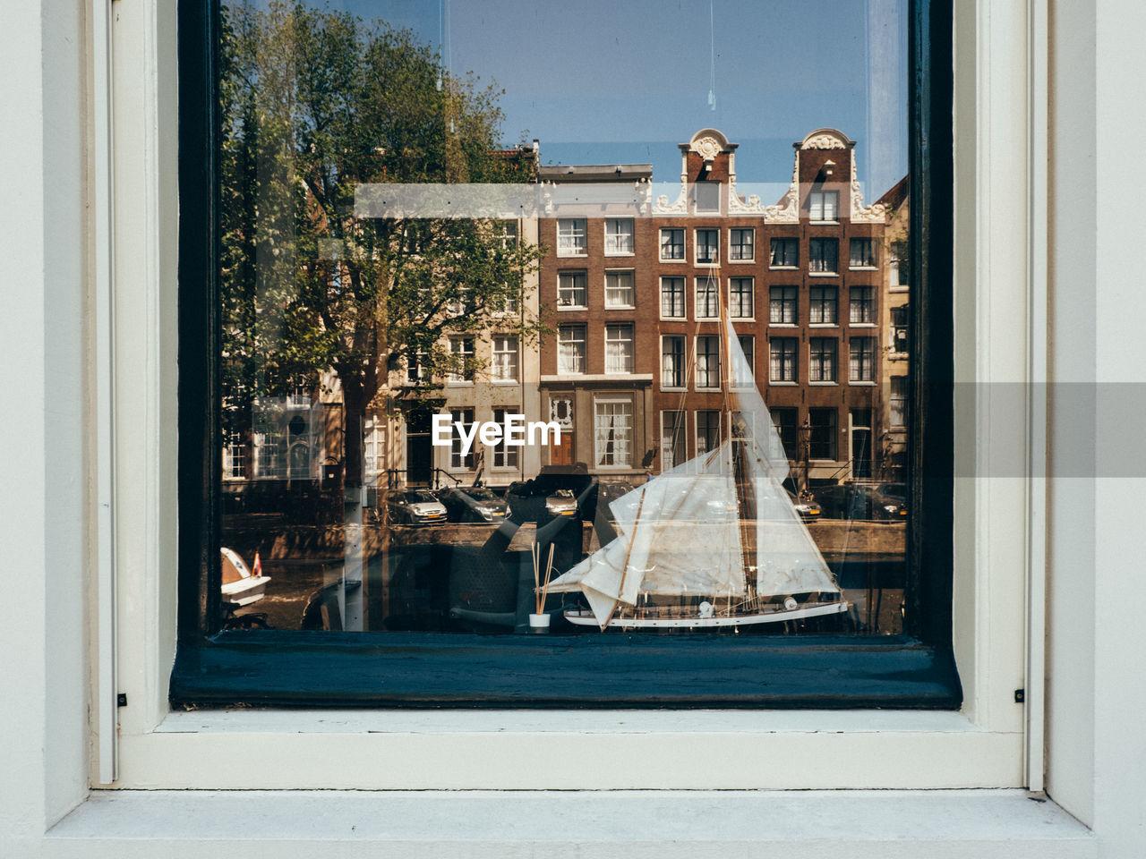 City buildings seen through window