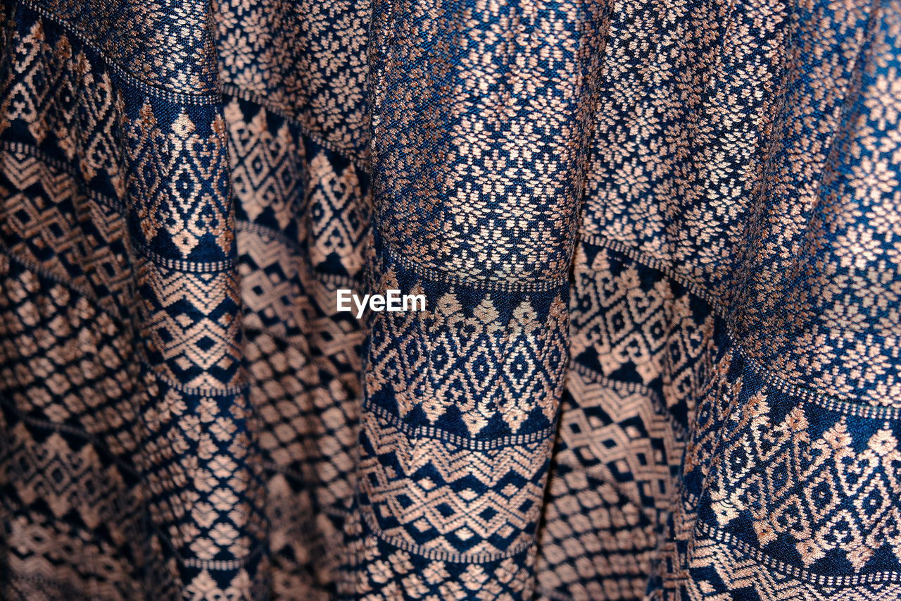 pattern, textile, backgrounds, full frame, no people, close-up, design, indoors, art and craft, textured, craft, clothing, fashion, creativity, variation, wool, retail, for sale, material, choice, floral pattern