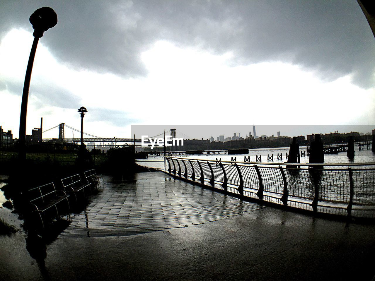 sky, built structure, cloud - sky, railing, architecture, river, water, day, building exterior, outdoors, street light, no people, city, nature