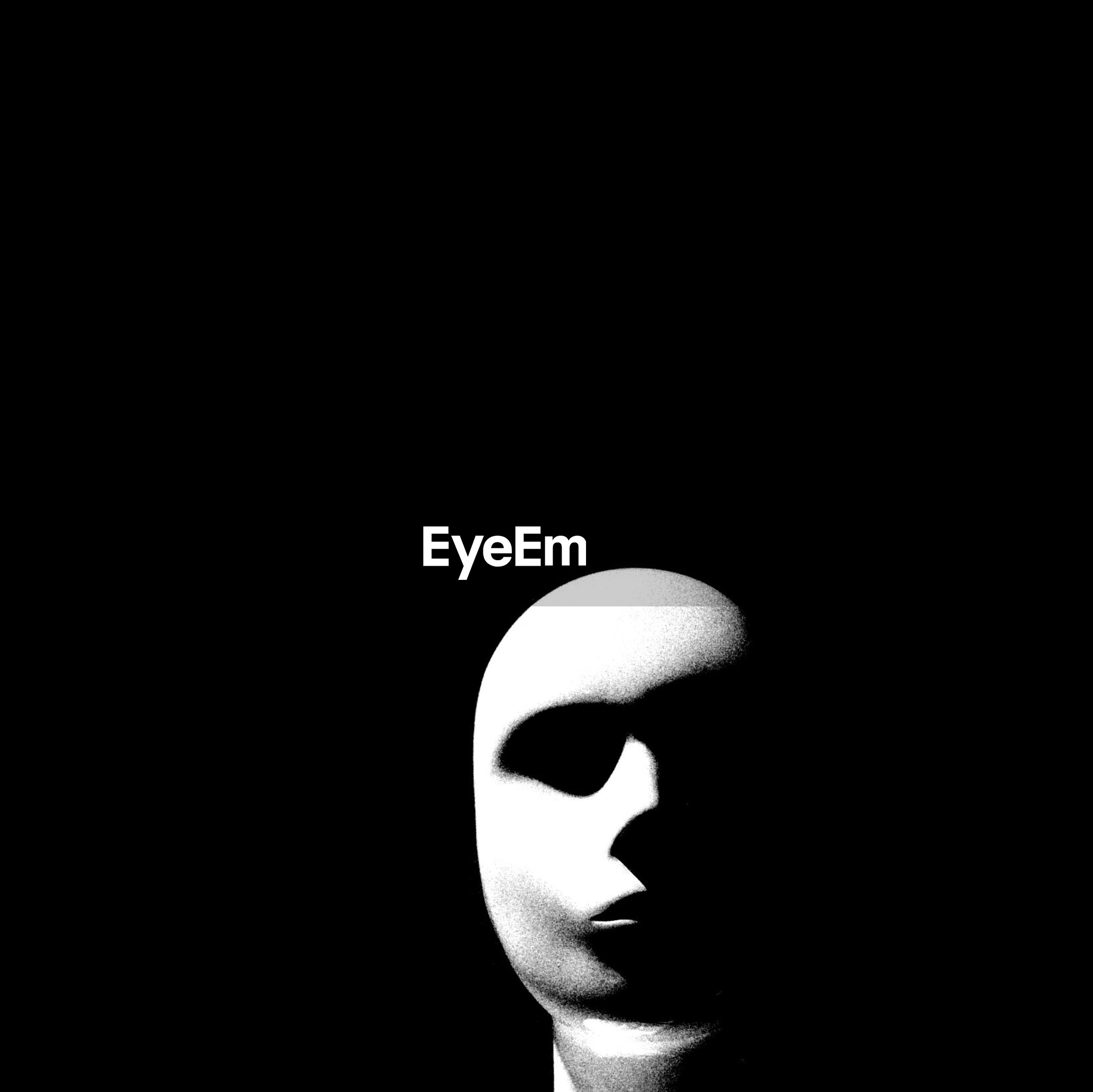 Mannequin head against black background