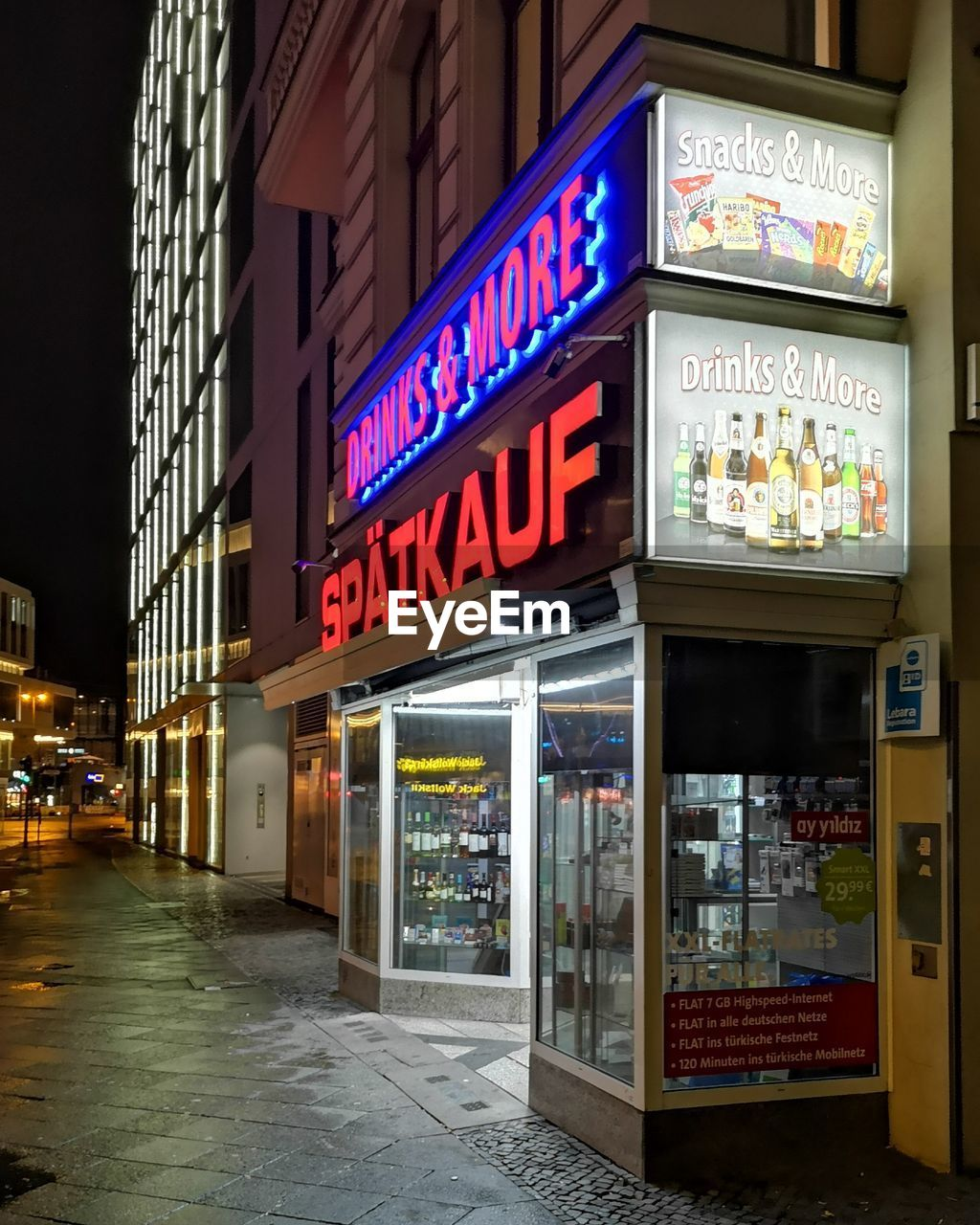 illuminated, communication, text, city, night, architecture, building exterior, built structure, western script, sign, store, no people, neon, retail, commercial sign, business, street, food and drink, outdoors, building, store sign, nightlife