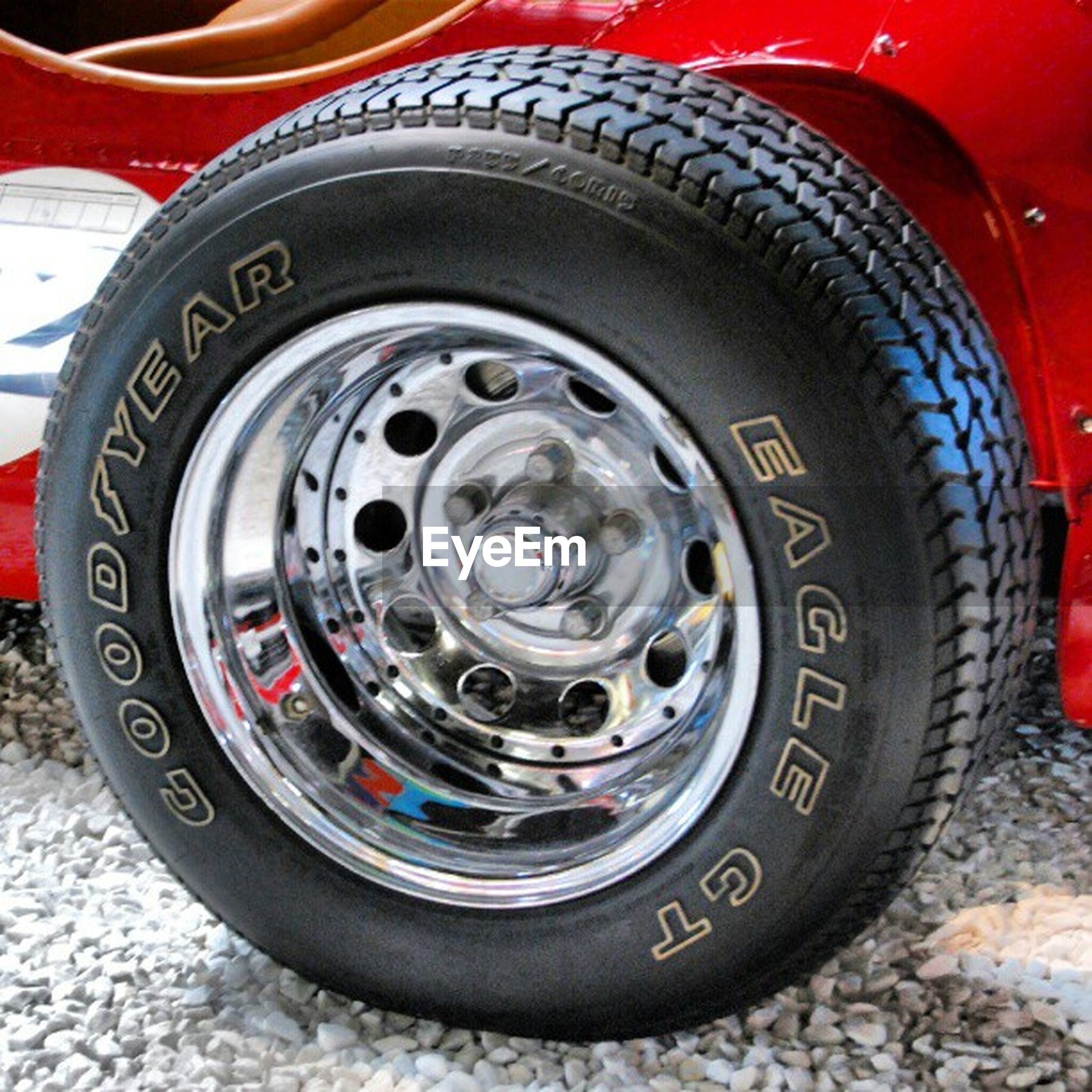 transportation, land vehicle, mode of transport, car, close-up, metal, old-fashioned, wheel, red, vehicle part, retro styled, tire, machine part, number, part of, circle, no people, old, vintage car, headlight