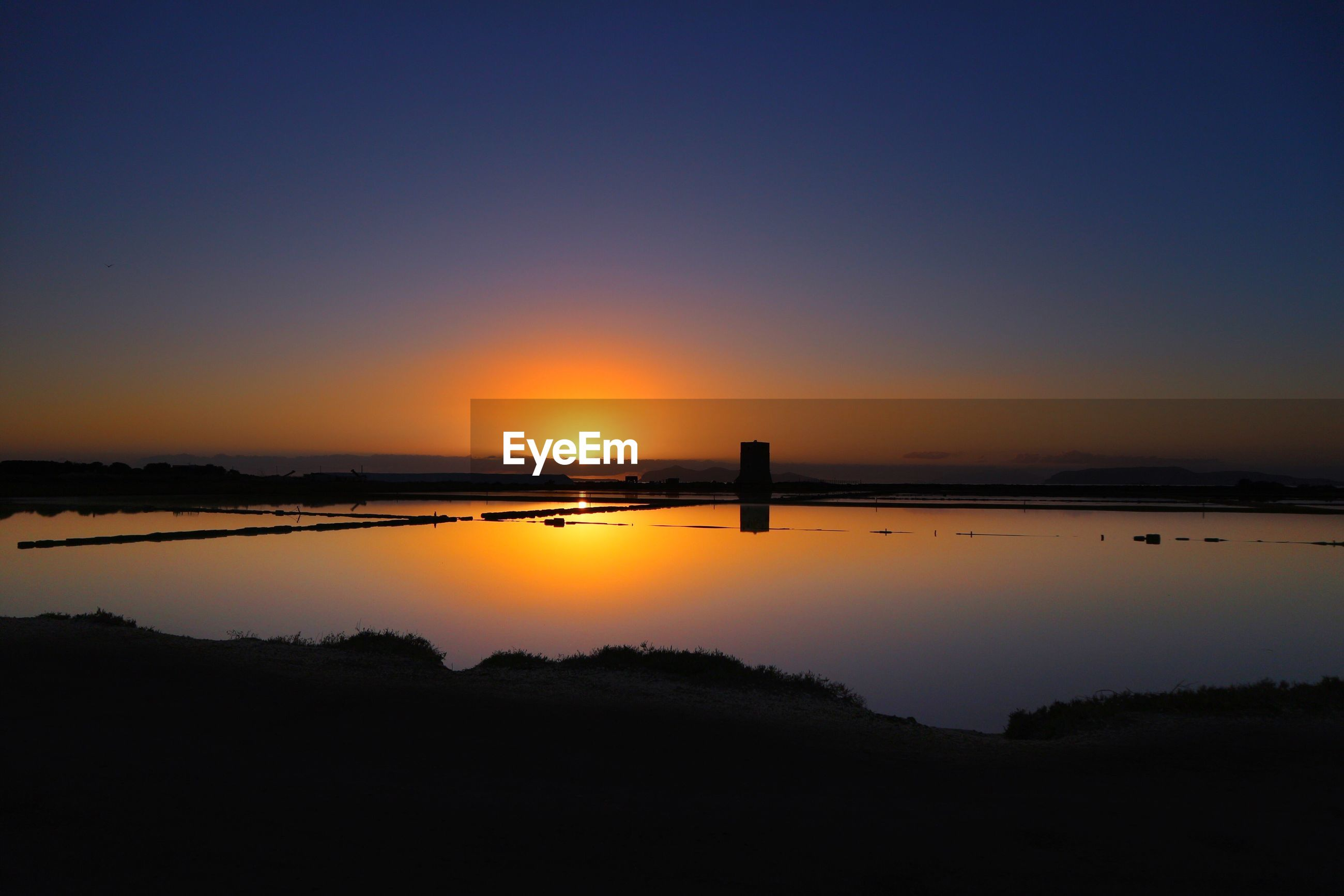VIEW OF SUNSET OVER WATER