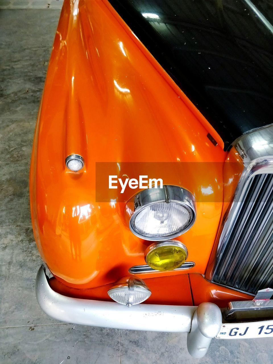 car, orange color, transportation, land vehicle, mode of transport, no people, close-up, stationary, day, outdoors