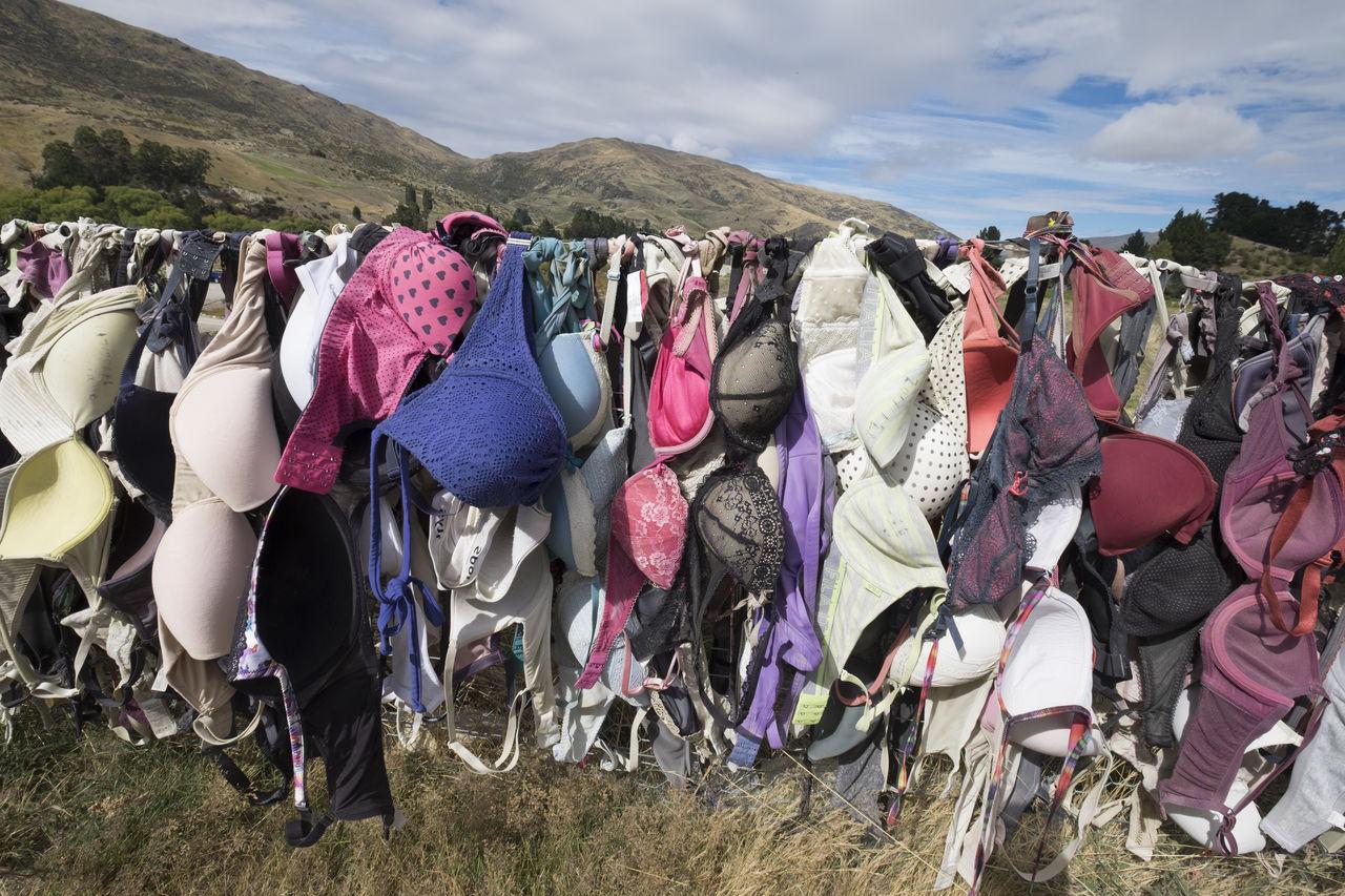 Multi colored bras at market for sale