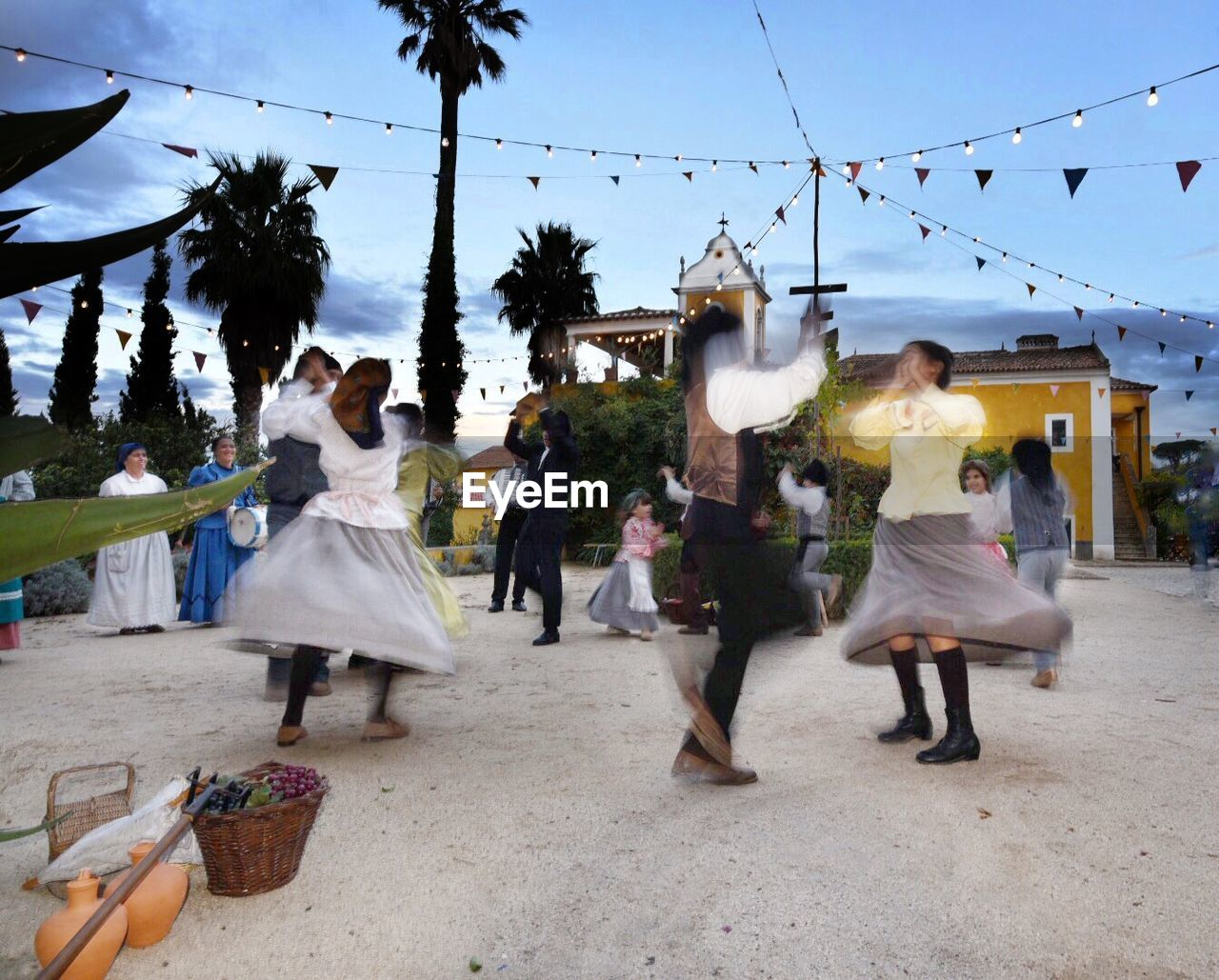 wedding, celebration, bride, women, dancing, walking, bridegroom, enjoyment, fun, men, full length, large group of people, wedding dress, day, outdoors, real people, life events, building exterior, sky, togetherness, architecture, tree, young adult, groom, adult, people, adults only