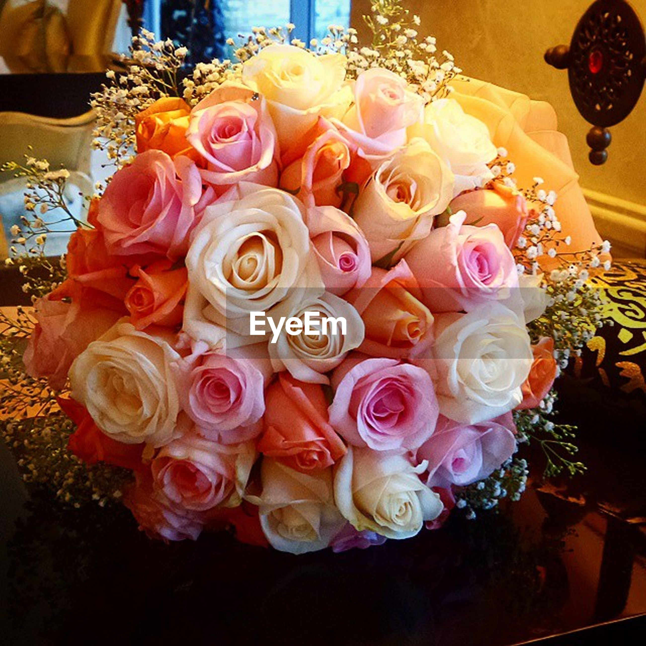 indoors, flower, freshness, bouquet, rose - flower, variation, vase, petal, decoration, table, still life, arrangement, bunch of flowers, fragility, flower arrangement, choice, multi colored, flower head, high angle view, close-up
