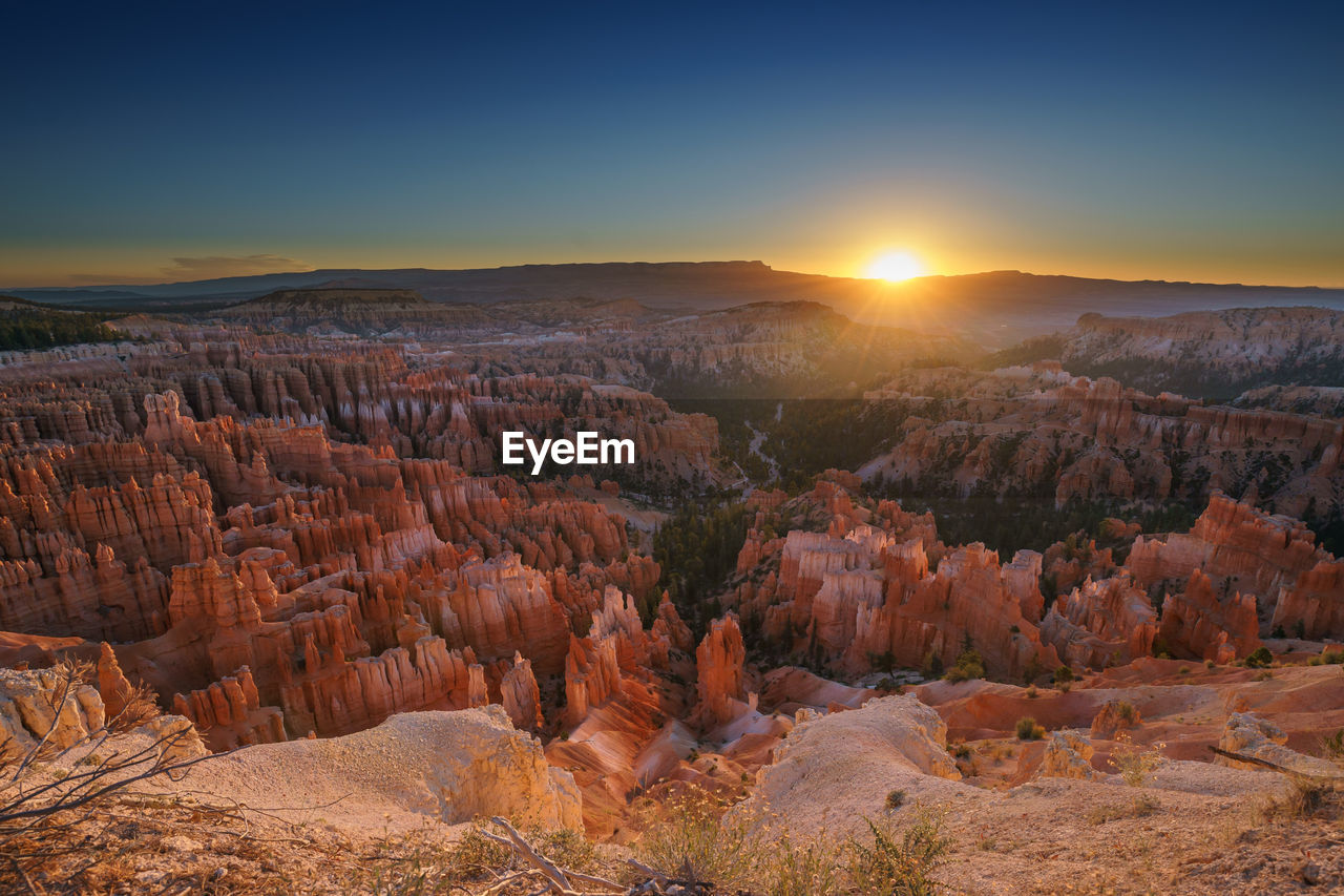 Scenic view of sunset over rock formations