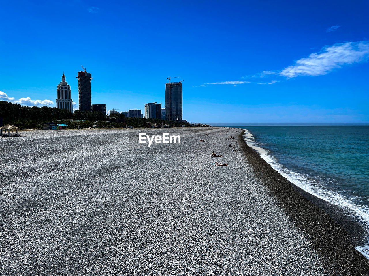 SCENIC VIEW OF SEA AGAINST SKY IN CITY