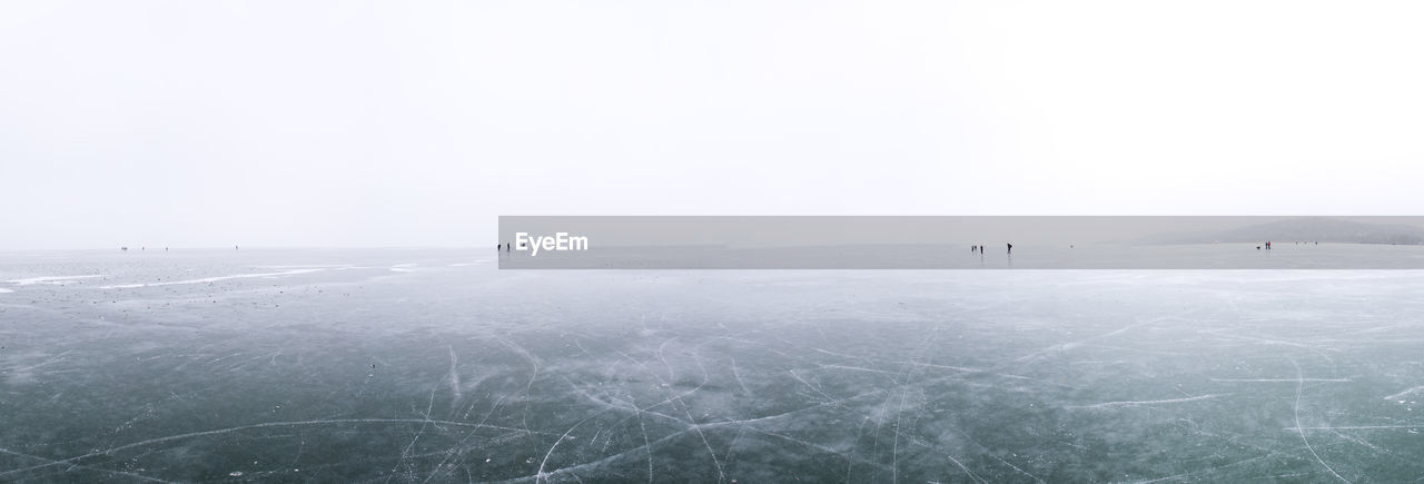 SCENIC VIEW OF FROZEN LANDSCAPE AGAINST CLEAR SKY