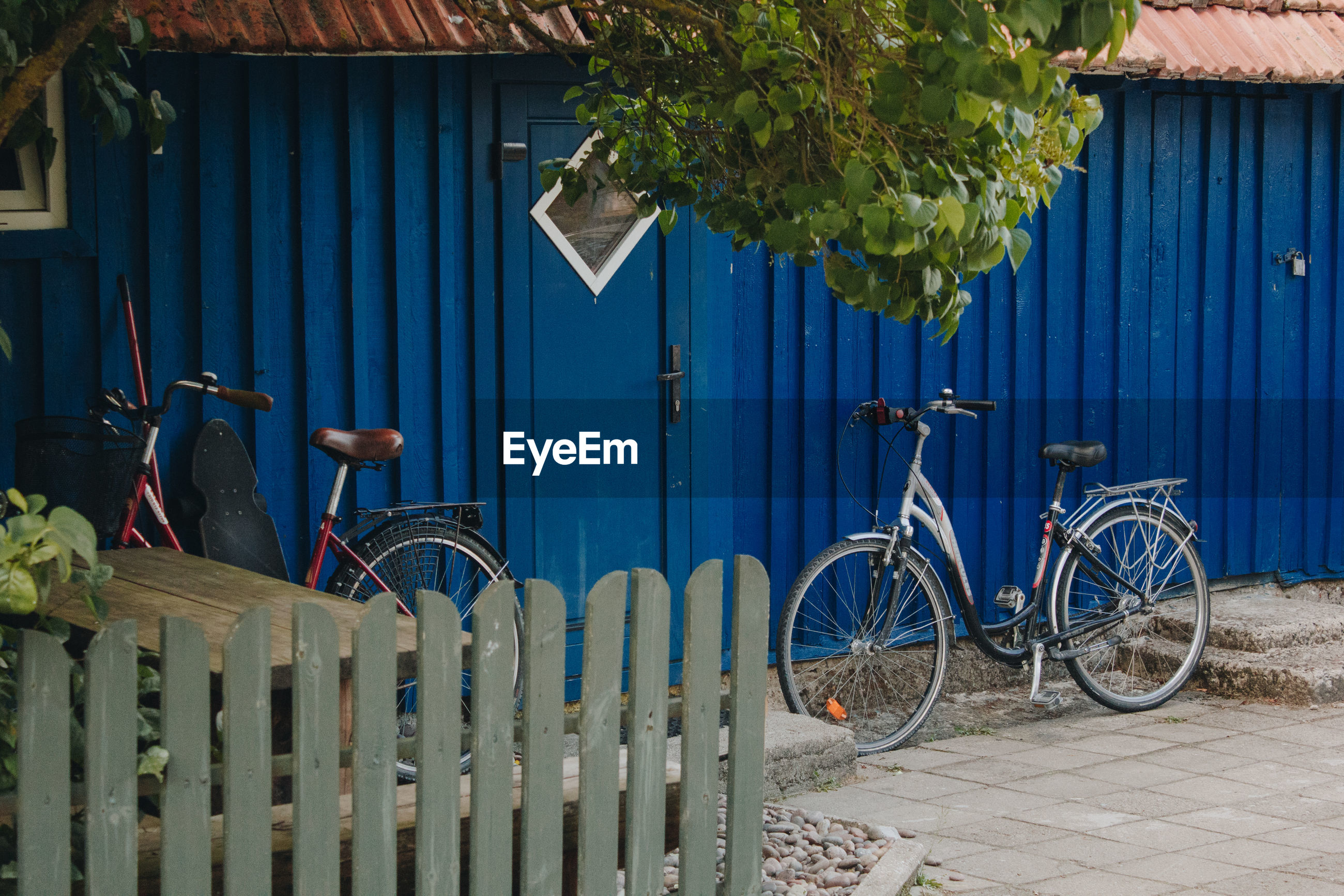 BICYCLE PARKED OUTSIDE HOUSE