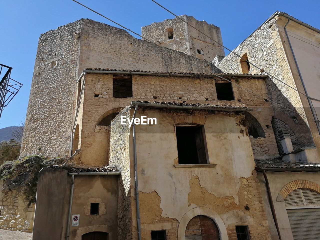 architecture, built structure, building exterior, low angle view, building, sky, window, no people, old, clear sky, history, the past, day, nature, religion, abandoned, spirituality, belief, place of worship, outdoors