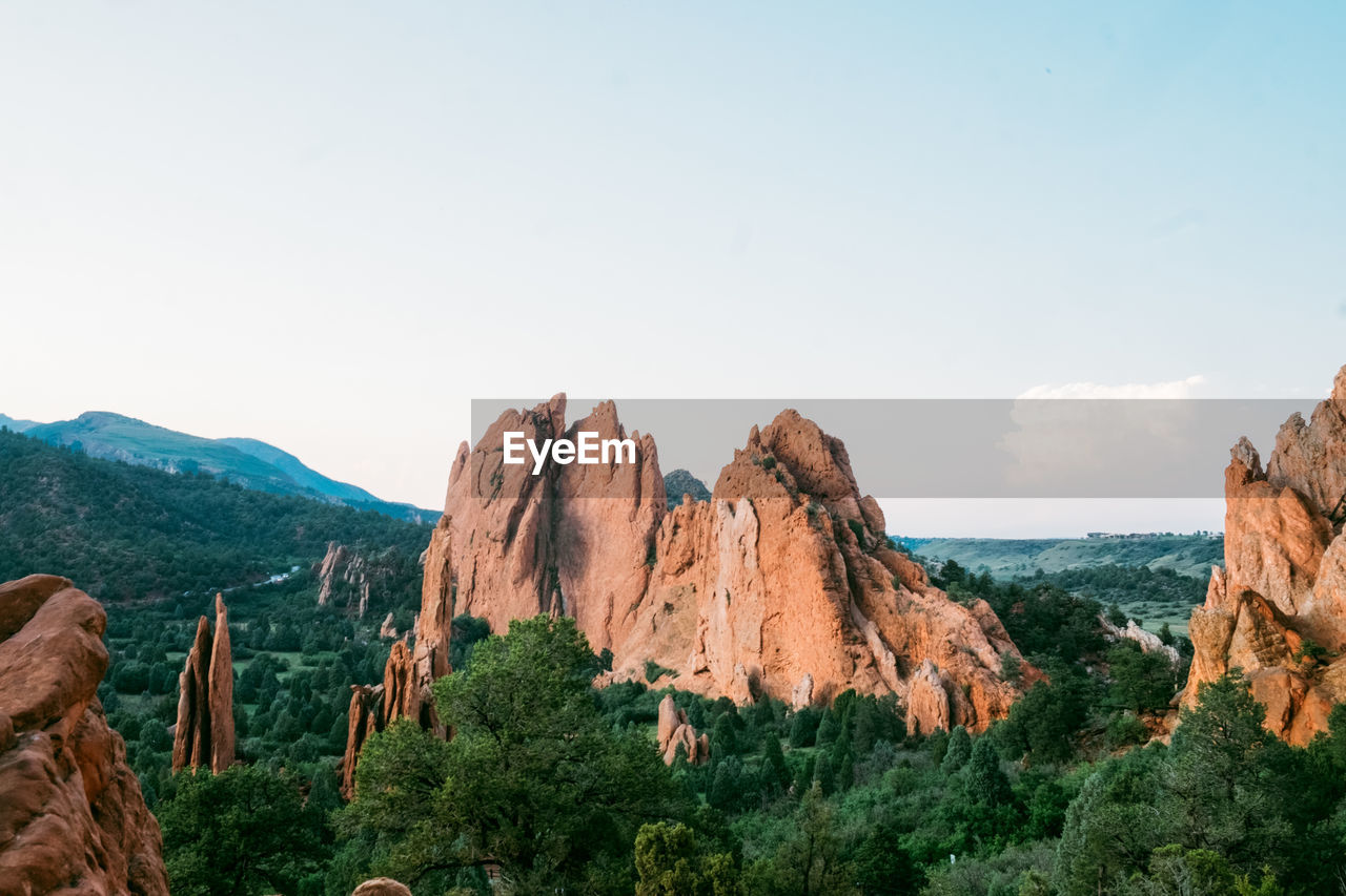 sky, beauty in nature, scenics - nature, mountain, tranquil scene, tranquility, nature, rock, environment, landscape, plant, non-urban scene, no people, copy space, idyllic, sea, rock - object, day, horizon, solid, outdoors, formation