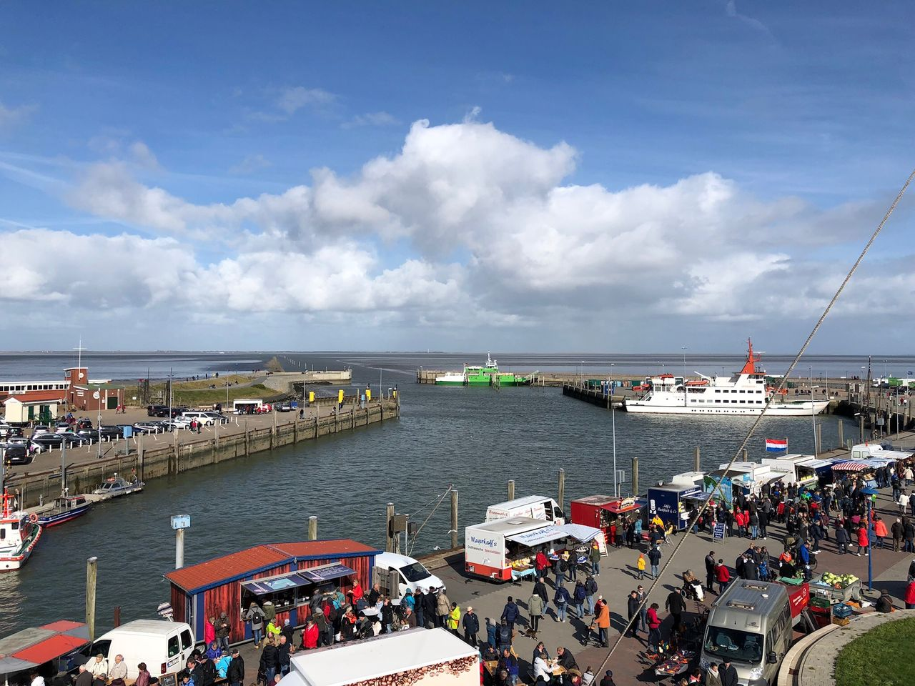 water, transportation, nautical vessel, cloud - sky, sky, mode of transportation, sea, group of people, large group of people, day, high angle view, crowd, architecture, nature, real people, ship, travel, harbor, pier, outdoors, horizon over water, passenger craft