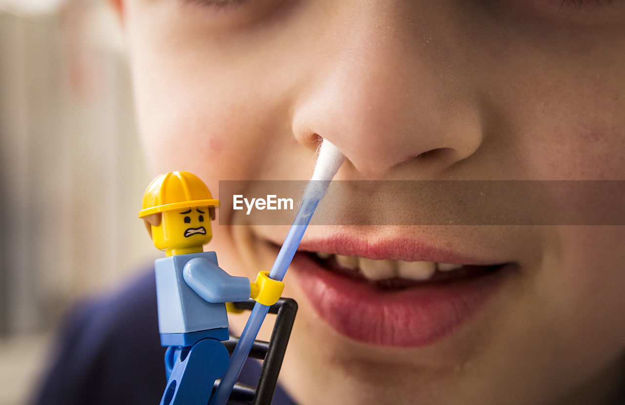 yellow, human face, close-up, healthcare and medicine, human lips, human body part, real people, indoors, one person, patient, technology, day