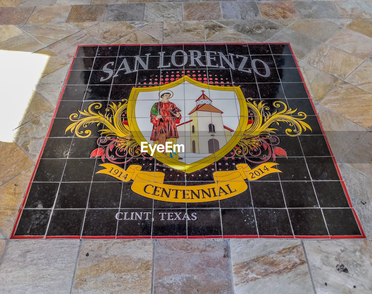 text, communication, western script, high angle view, sign, day, no people, representation, capital letter, flooring, human representation, yellow, information, non-western script, information sign, creativity, outdoors, art and craft, tile, architecture, message, tiled floor