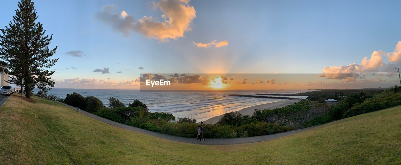 sky, sunset, water, scenics - nature, beauty in nature, cloud - sky, plant, sea, tranquil scene, land, tranquility, horizon, horizon over water, orange color, nature, sun, beach, tree, idyllic, no people, outdoors